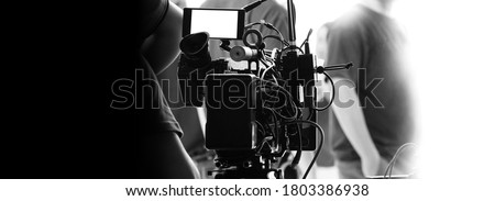 Behind the scenes of video recording or filming online movie by 8K high definition digital camera and professional monitor. And flare lighting set up with film crew team in the studio production. Foto d'archivio ©