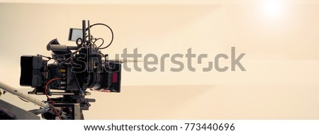 Behind the scenes of video shooting production crew team and professional camera equipment in studio.