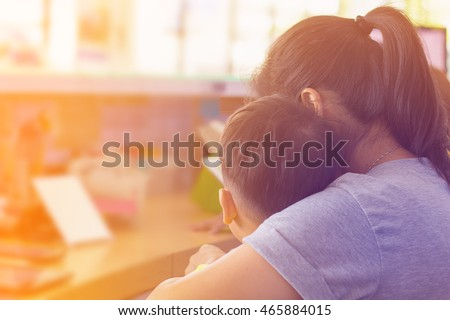 Shutterstock Behind view Mother and Sun  kissing and hugging. Happy Family,copy space.filter color effect.