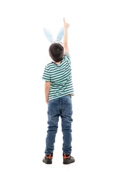 Behind view of young boy with Easter bunny ears showing direction pointing finger up. Full length isolated on white background.