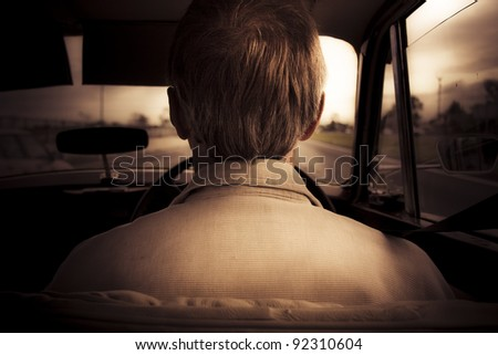Behind View On The Head Of A Vintage Male Car Enthusiast Driving A Old Fashioned Classic Car During A Nostalgic Road Trip Down Memory Lane
