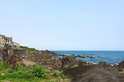 Bei-guan Tidal Park . numerous types of terrain of marine abrasion , inxluding Chessboard Rock, One line sky and more. With waves crashing against the reeves,it forms various types of odd terrain.