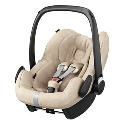 Beige Baby Carrier Isolated on White Background. Side View of Brown Child Safety Seat. Modern Restraining Car Seat with Side Impact Protection. Travel Gear. Infant Restraint System