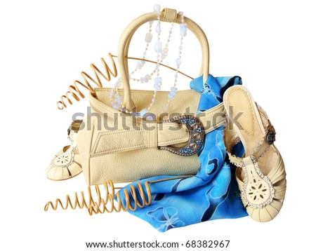 Beige bag and shoes, blue pareo, moonstone beads, dried branches, isolated on white