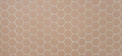 Beige ceramic bathroom wall tile. Hexagon mosaic tiles texture with white filling.