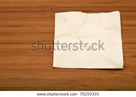 beige cocktail napkin on wooden (Bamboo) table