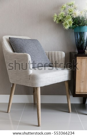 beige color upholstered chair...