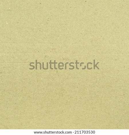 Beige copyspace paper cardboard fragment as a background texture