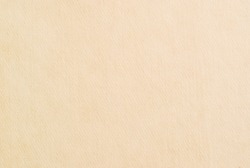 Beige embossed craft paper texture as background