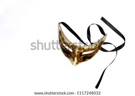 Beige-gold Venetian mask with black satin lace on a white background to hold your text #1117248032