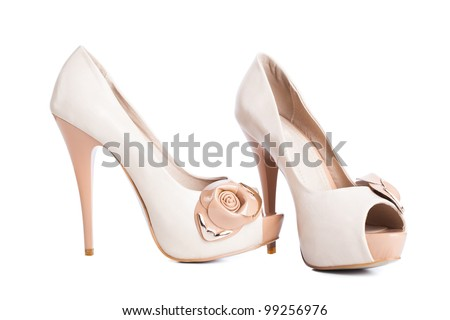 Beige high heel shoes isolated on white