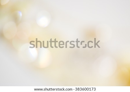 Beige ivory background with soft glowing lights and beautiful bokeh with shine lights. Backdrop for wedding cards