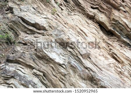 Beige layered rocks pattern, close-up