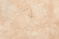 Beige low contrast smooth decorative plaster concrete textured background. Abstract soft neutral antique artistic backdrop texture to your concept or product