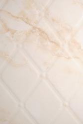 Beige marble textured tiles in the bathroom