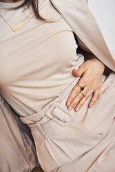 Beige Monochromatic outfit  with a beige suit and rings.