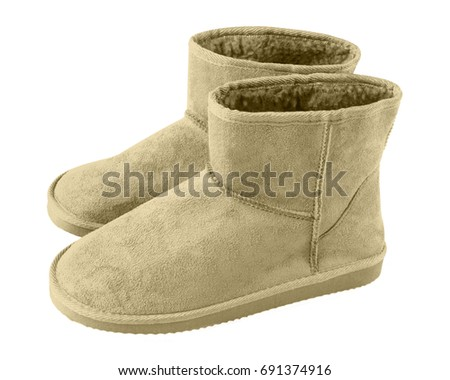 Beige pair of short winter u g g boots isolated white #691374916