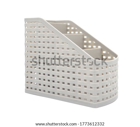 Beige plastic organaizer with partitions isolated on white background.