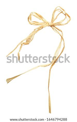 Beige raffia bow isolated on white Photo stock ©