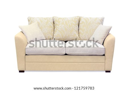 Beige sofa with cushions isolated on white.