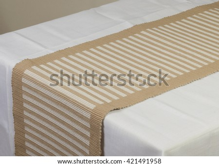 Beige striped dining table runner on white cover #421491958