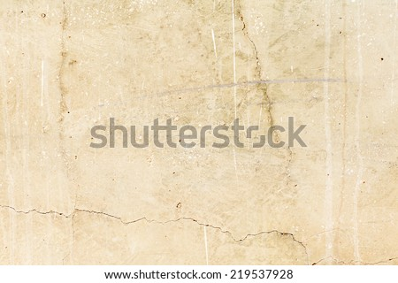 beige textured wall with peeling damaged more scratch
