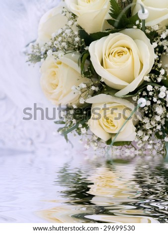 beige wedding bouquet reflecting in water