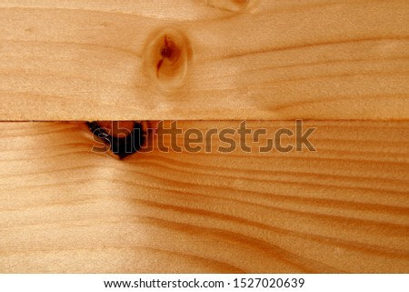 Beige wooden background with wooden lines and wooden rings.