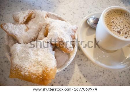 Beignets and Cafe Au Lait at New Orleans Cafe du Monde in New Orleans Stock fotó ©