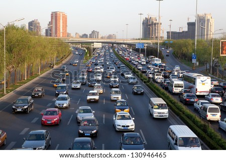 BEIJING-APR 14: Traffic jam on Apr.14, 2011 in Beijing,China. The Beijing municipal government has the controlling traffic jams at the top of the to-do list to benefit people in 2013 - stock photo