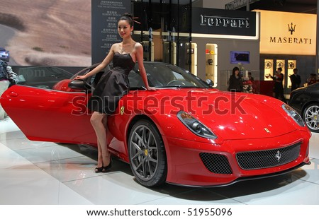 BEIJING – APRIL 27: A model stands beside a Ferrari 599 GTO car is on display at the 2010 Beijing International Automotive Exhibition (Auto China 2010) on April 27, 2010 in Beijing, China.