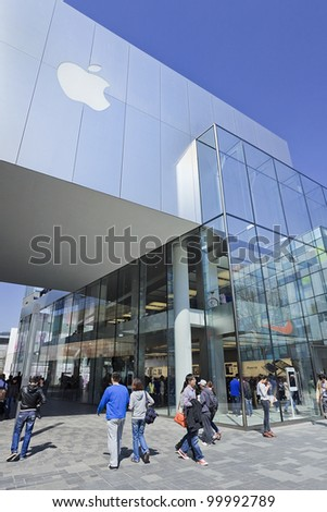 BEIJING-APRIL 3, 2012. Apple flagship store on April 3, 2012 in Beijing. In 2011, Apple sold 172 million iPods, iPhones and iPads, These post-PC devices making up a total of 76-percent of its revenue - stock photo