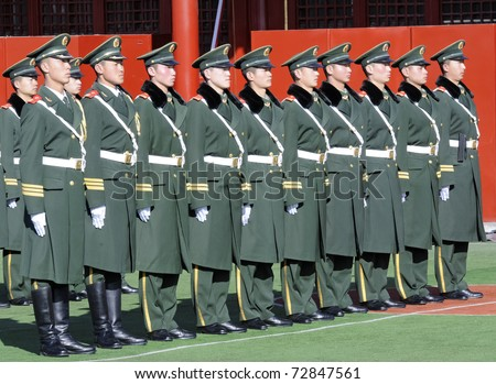 BEIJING - APRIL 2: Chinese soldiers prepare for the national flag ceremony on April 2, 2010 in Beijing, China. Every movement needs to be very precise.