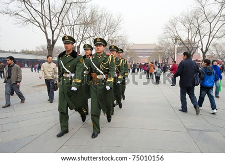 BEIJING - APRIL 2: Chinese soldiers prepare for the national flag ceremony on April 2, 2010 in Beijing, China. Here soldier are marching to the flag pole.