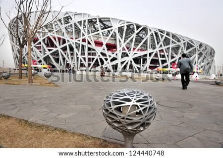 BEIJING - APRIL 04:Visitors at the Bird's Nest Stadium on April 04 2009 in Beijing, China.Beijing National Stadium is believed to be the world's largest enclosed space.