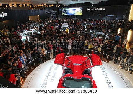 BEIJING - APRIL 27: Visitors crowded the Mercedes-Benz booth at the 2010 Beijing International Automotive Exhibition (Auto China 2010) on April 27, 2010 in Beijing, China.