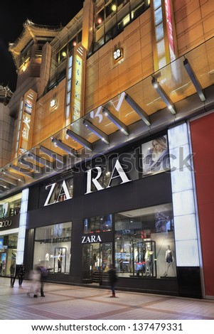 BEIJING-APRIL 14. Zara outlet at night. Zara owner, Spain Inditex, has reported annual profits of $2.6 billion up 11% on the previous year. It has now 5,527 stores worldwide. Beijing, April 14, 2013.