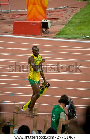 BEIJING - AUG 16: Sprinter Usain Bolt's victory lap after setting world record for men's 100 Meter sprint at the Olympics. Bolt later gains the title World's Fastest Man August 16, 2008 Beijing, China