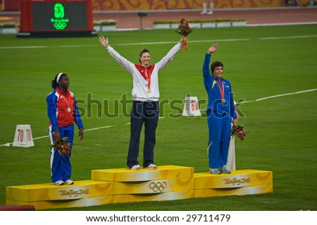 BEIJING - AUG 16: Stephanie Trafton Brown, USA, receives the gold medal for women's Discus throw.  Yarelys Barrios, Cuba, silver. Olena Antonova, Ukraine, bronze. August 16, 2008 Beijing, China