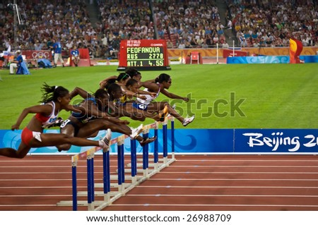 BEIJING - AUGUST 18: Athletes clear the hurdles during the women's 110M hurdles race at the Beijing Summer Olympics. August 18, 2008 Beijing, China