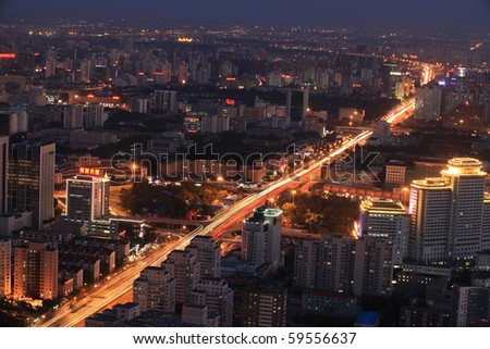 BEIJING - AUGUST 22: Cityscape of Beijing city at dusk on August 22, 2010 in Beijing, China. Beijing is the Capital of China, the second-largest economy in the World.