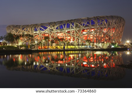"BEIJING - AUGUST 5:  The National Stadium referred to as the ""Bird's Nest"" is lit at dusk for an opening ceremony dress rehearsal prior to the 2008 Olympic Games August 5, 2008 in Beijing, China."