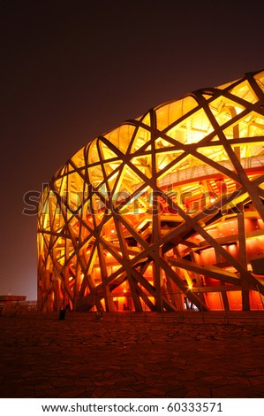 BEIJING, CHINA - AUG 8: First anniversary celebration of Olympic game on August 8, 2009 in Beijing. Stadium is light up in red.