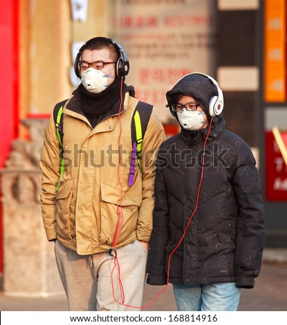 BEIJING CHINA-DEC 25 213 People is seen with face mask a high-ranking environmental official has estimated cleaning up China's air pollution will cost 1.75 trillion yuan between 2013 and 2017