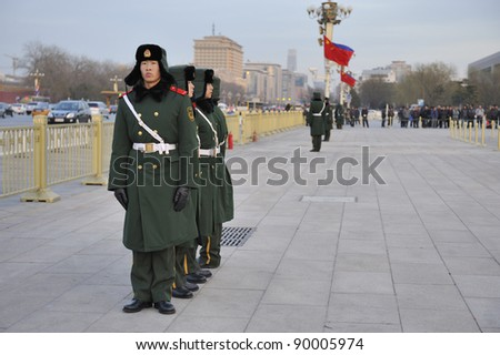 BEIJING, CHINA- DECEMBER 13: Unidentified military personnel stand guard in front of the Forbidden City of Beijing, China on December 13, 2010.  In 1987 the Forbidden City was declared a UNESCO World Heritage Site.
