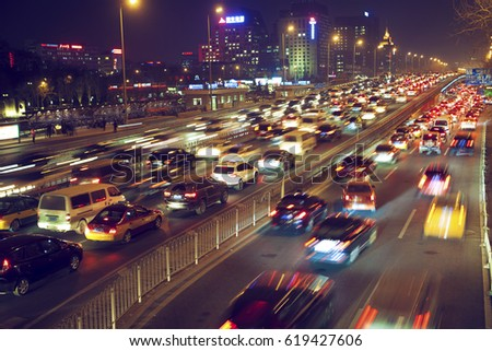 Beijing - China - December 23, 2016: with the increase in cars, traffic jams in Beijing is very serious. The car moved slowly in the rush hour. #619427606