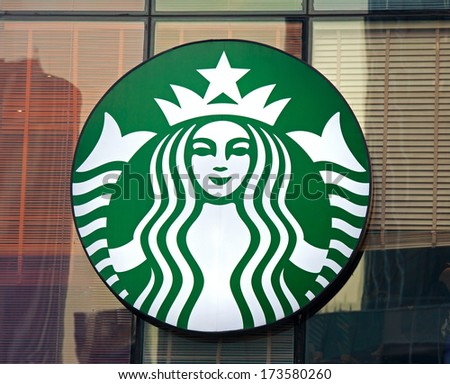 BEIJING, CHINA - JANUARY 22, 2014: Starbucks sign is displayed at the facade of a Starbuks store. Starbucks is the largest coffeehouse company in the world, with 20,891 stores in 62 countries