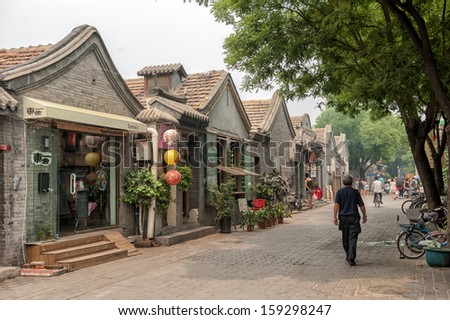 BEIJING CHINA JUNE19 The main street in the Jingyang Hutong on June 19 2012 in Beijing The Hutongs are popular among tourists as they provide a glimpse of life in Beijing centuries ago