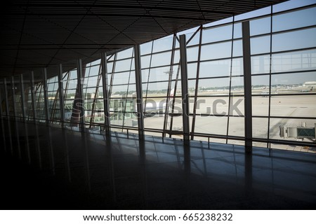 Beijing - China - June 20, 2017:View in interior Beijing Capital Airport Terminal 3, the world's largest airport terminal-building complex built in a single phase with 986,000 m2 floor.   #665238232