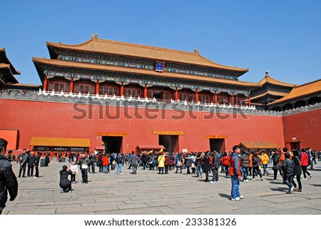 BEIJING, CHINA - MARCH 25, 2010: People visiting Tiananmen Gate to Forbidden City in Beijing, China. The Forbidden City is China\'s top tourist attraction, drawing more than 7 million visitors a year.